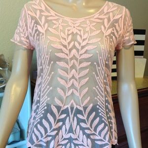 Sheer light pink top with some embroidering